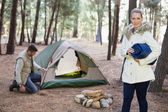 Young couple with tent in the wilderness — Stock Photo