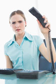Classy furious businesswoman hanging up phone — Stock Photo