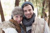 Couple in winter clothing in the woods — Stock Photo