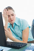 Classy wincing businesswoman having a headache — Stock Photo