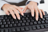 Close-up of hands typing on a keyboard — Stock Photo