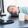 Cute businesswoman sitting on her swivel chair napping — Stock Photo
