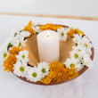 Stock Photo: Flowers and lit candle