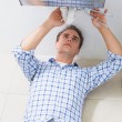 Stock Photo: Plumber repairing washbasin drain in bathroom