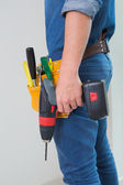 Side view mid section of a handyman with drill and toolbelt — Stock Photo