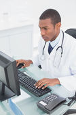 Doctor using computer at medical office — Stock Photo