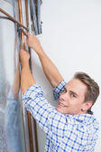 Technician servicing an hot water heater' pipes — Stock Photo
