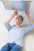 Plumber repairing washbasin drain in bathroom — Stock Photo