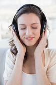 Close up of relaxed casual woman enjoying music — Stock Photo