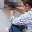 Stockfoto: Plumber repairing washbasin drain in bathroom
