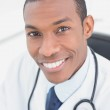 Close up portrait of a smiling male doctor — Stock Photo