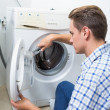 Technician repairing a washing machine — Foto Stock