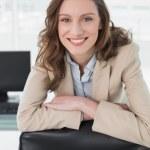 Elegant smiling businesswoman at office desk — Stock Photo #36335789