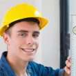 Close up of a handyman using a spirit level — Stock Photo