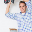 Handyman using cordless drill to the ceiling — Stock Photo