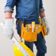 Mid section of a handyman with toolbelt and hard hat — Stock Photo #36339029