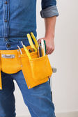 Mid section of a handyman with toolbelt — Stock Photo