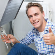 Plumber repairing washbasin drain while gesturing thumbs up — Stock Photo #36340339