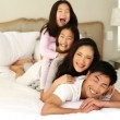 Silly family playing on the bed — Stock Video #36404591