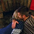 Cute couple celebrating christmas together in front the fireplace — Stock Video