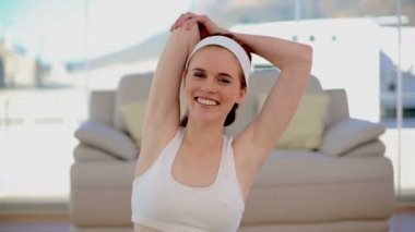 Content smiling woman stretching her arms — Stock Video