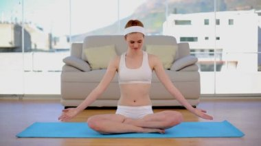 Content calm woman meditating in her living room — Stock Video