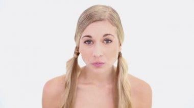 Smiling nude blonde using tweezers — Stock Video