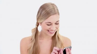 Smiling nude blonde using smartphone — Stock Video