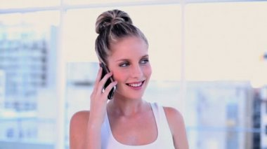 Happy blonde woman phoning with her smartphone — Stock Video
