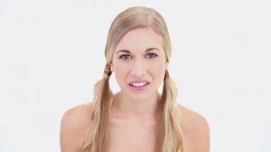 Happy nude blonde using tweezers — Stock Video