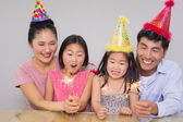 Cheerful family of four playing with firecrackers — Stock Photo