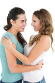 Young female embracing her friend — Stock Photo