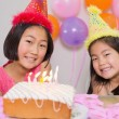 Cute little girls at birthday party — Stock Photo