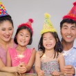 Family of four playing with firecrackers at a birthday party — Stock Photo
