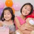 Cute little girls at a birthday party — Stock Photo #37832215