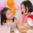 Cute little girls at a birthday party — Stock Photo