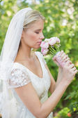 Peaceful bride smelling her bouquet — Foto Stock