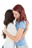 Side view of a young female embracing her friend — Stock Photo