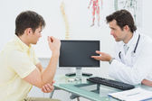 Doctor in conversation with patient at office — Stock Photo