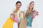 Portrait of cheerful women standing with shopping bags — 图库照片