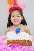 Smiling little girl at her birthday party — Stock Photo
