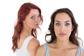 Unhappy young female friends not talking after argument — Stock Photo
