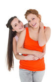 Young female embracing her cheerful friend — Foto Stock