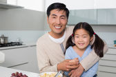 Portrait of a happy father with daughter in kitchen — Stock Photo