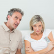 Couple watching tv in the living room — Stock Photo