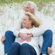Romantic senior couple relaxing at beach — Stock Photo #38984091