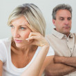 Angry couple sitting on sofa after a fight — Stock Photo