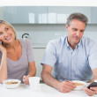 Couple reading text messages while having breakfast — Stock Photo #38985815