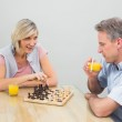 Concentrated couple playing chess — Stock Photo