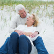 Romantic senior couple relaxing at beach — Stock Photo #38986625